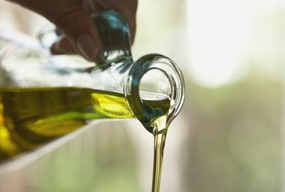 Olive oil pouring from bottle