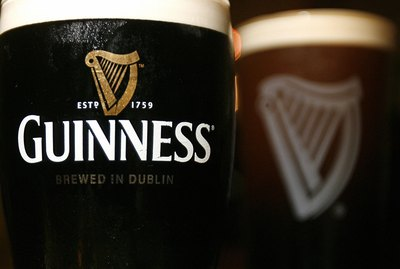 Pints of Guinness beer are pictured in L