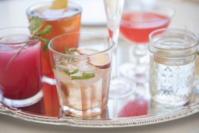 Cocktails in glasses on tray