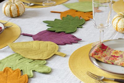 This colorful DIY felt fall leaves table runner is easy to make, will brighten up your fall table and make all your meals feel special.