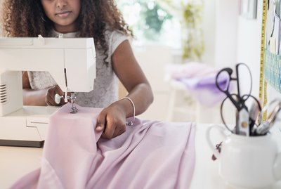 Black woman using sewing machine