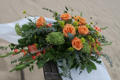 orange flower arrangement wedding
