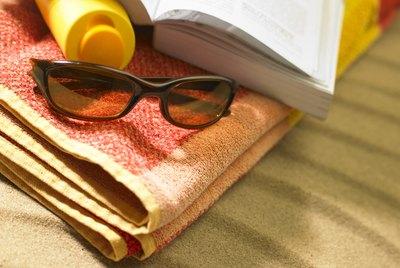 Sunglasses on beach towel