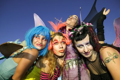 Women wearing fairy costumes posing together