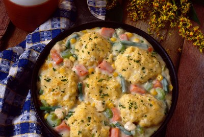 Southern chicken vegetables and dumplings in skillet