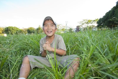 Boy sitting on grass, Japan