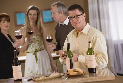 Man at party with wine