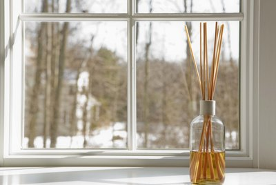 Aroma reed diffuser by window