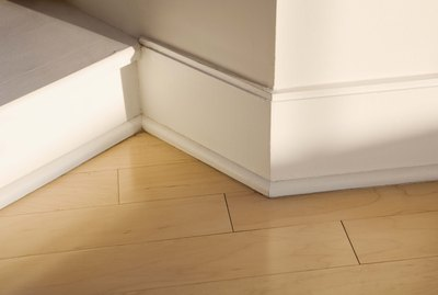 Baseboard and wooden floor