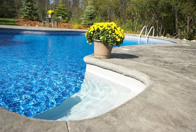 Flowerpot on edge of swimming pool