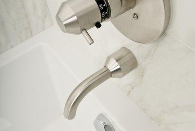 Stainless steel fixtures in bathtub