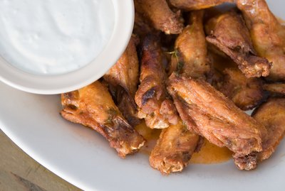 Plate of buffalo wings and ranch dressing