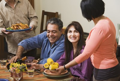 Middle-aged Hispanic couple at dinner party