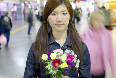 Woman holding flowers in airport