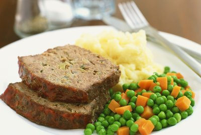 Meatloaf, potatoes, peas and carrots