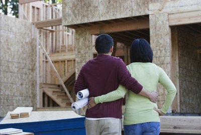 Asian couple looking at new construction