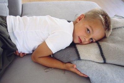 Boy lying down on blanket