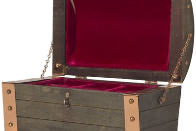 Open wood chest lined in velvet