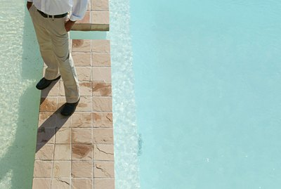 Man standing by pool