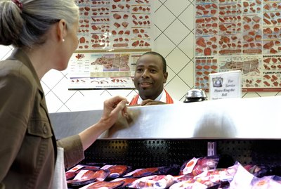 Butcher attending to customer