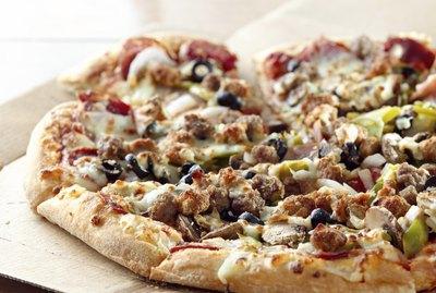 pizza sitting on cardboard box