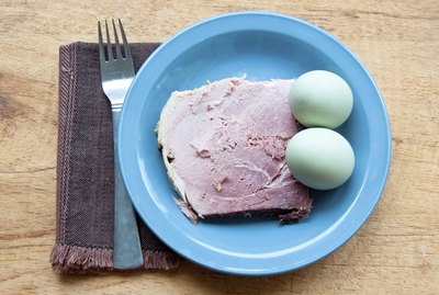 Green eggs and ham with fork, napkin