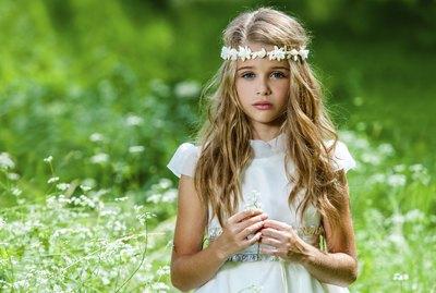 Beautiful pre teen in green field.