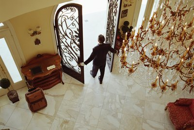 Hotel attendant opening doors, elevated view