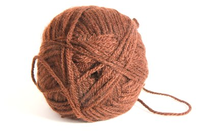 Ball of brown wool thread for knitting isolated