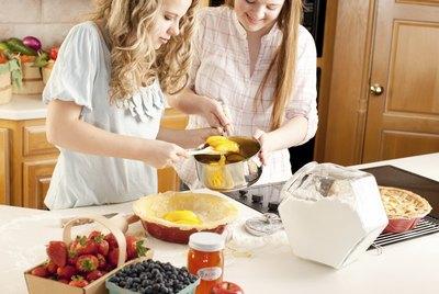 Baking: Caucasian Teenage Girl Friends Making Homemade Fruit Dessert