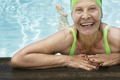 Smiling senior woman swimmer in pool