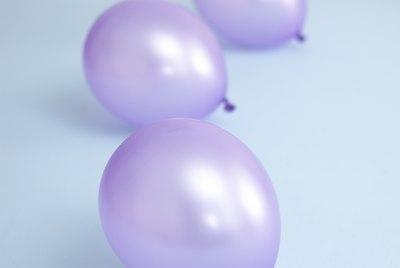 Three purple balloons.
