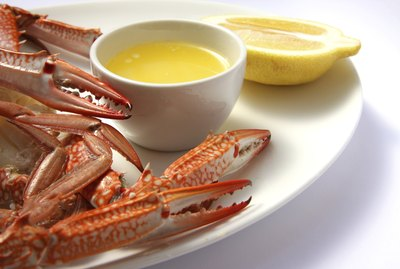 Crab legs with melted butter and lemon