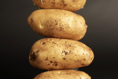 Close-up of potatoes stacked high on top of each other