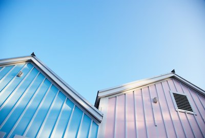 Exterior of warehouse storage sheds in pink and blue