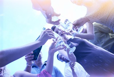 low angle view of a group of people toasting