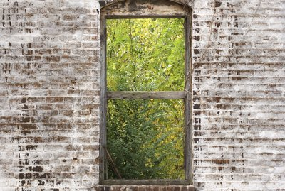 Window frame in decaying brick wall