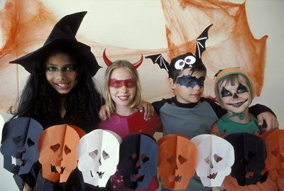 Portrait of children dressed up Halloween costumes