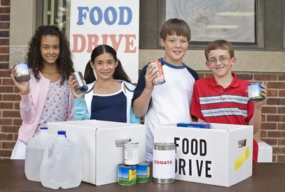 Kids volunteering at food drive