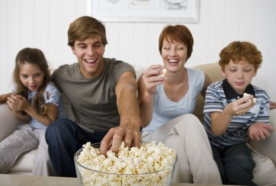 Family eating popcorn