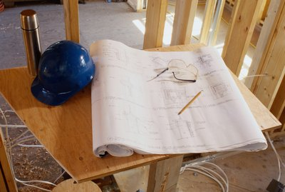 Blueprint and a Hard Hat Inside a Building Frame