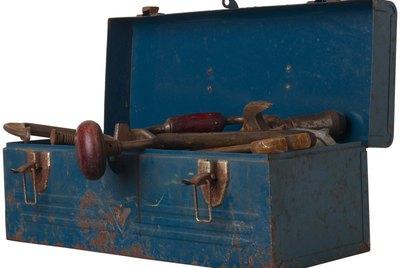Rusty tool in blue metal box L2