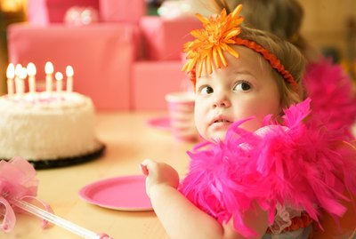 Curious baby girl at birthday party