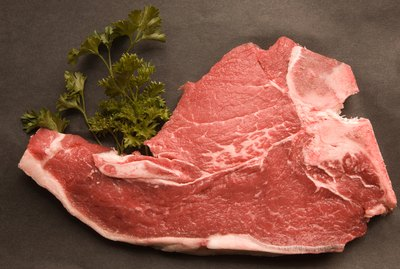 High angle view of raw pork chop