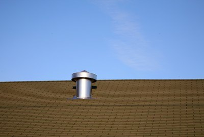 Roof of building with stovepipe vent