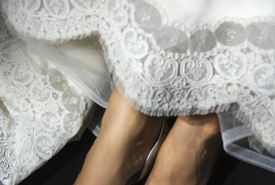 Feet of bride in gown