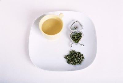 tray of herbal tea on white