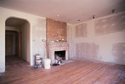 Unfinished living room with fireplace