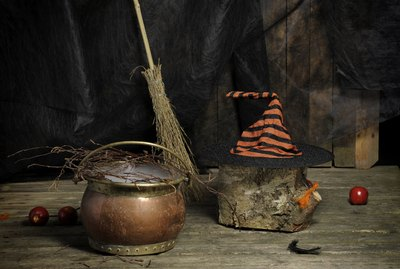 Halloween still live with hat, , broom and cauldron