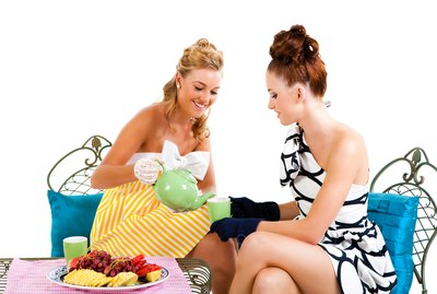 Two Young Women Having Tea - Isolated